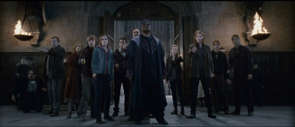 "(L-r) GEMMA JONES as MADAM POMFREY, MIRIAM MARGOLYES as Professor Pomona Sprout, WARWICK DAVIS as Professor Flitwick, MARK WILLIAMS as Arthur Weasley, JULIE WALTERS as Molly Weasley, RUPERT GRINT as Ron Weasley, EMMA WATSON as Hermione Granger, MATTHEW LEWIS as Neville Longbottom, DAVID THEWLIS as Remus Lupin, GEORGE HARRIS as Kingsley Shacklebolt, CLÉMENCE POÉSY as Fleur Delacour, DOMHNALL GLEESON as Bill Weasley, JAMES PHELPS as Fred Weasley and OLIVER PHELPS as George Weasley in Warner Bros. Pictures' fantasy adventure ""HARRY POTTER AND THE DEATHLY HALLOWS – PART 2,"" a Warner Bros. Pictures release."